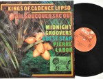 """Kings Of Cadence Lypso """"Ail Soucouer Sacou"""", Midnight Groovers, Guest Star: Pierre Labor, Disques Debs, HDD 585, 1976 Condition vinyl: Near Mint Condition sleeve: Excellent, it has a sticker from 70s soundsystem Coruba (see picture) Condition labels:clean € 65,-"""