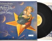 Mellon Collie And The Infinite Sadness, Hut, HUTTLP 30, 1996 This is the rare 1996 triple vinyl limited edition, numbered copy No.7671 Condition vinyl Record 1: Near Mint (a few minor scratches that are inaudible) Record 2: Mint Record 3: Mint Condition insert: Near Mint Condition sleeve: Near Mint € 200,-